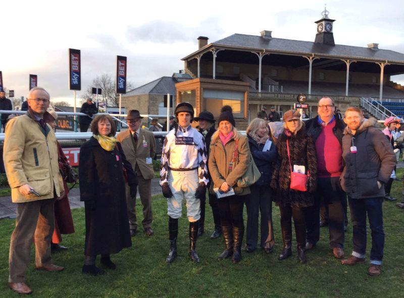 The owners of Our Belle Amie in the paddock before her bumper at Doncaster on Saturday