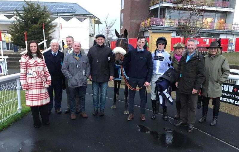 A happy team with Our Belle Amie.. She was second in the bumper