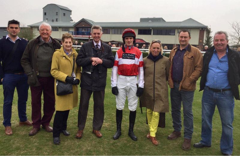 David Bass with some of Fifty Bob's owners before his run at Southwell yesterday