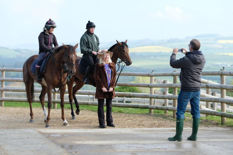 Philip Smedley taking a photo of  his sister, Angie Nile, and his horses Biscuit and Monrocco