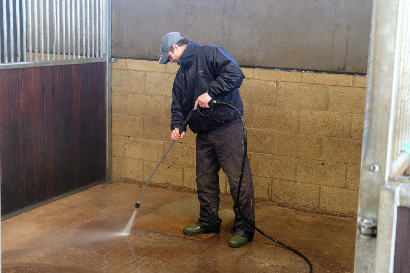 George steam cleaning the stables