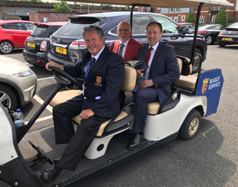 Norman Carter and Peter Kerr taking the taxi on arrival at Chester..