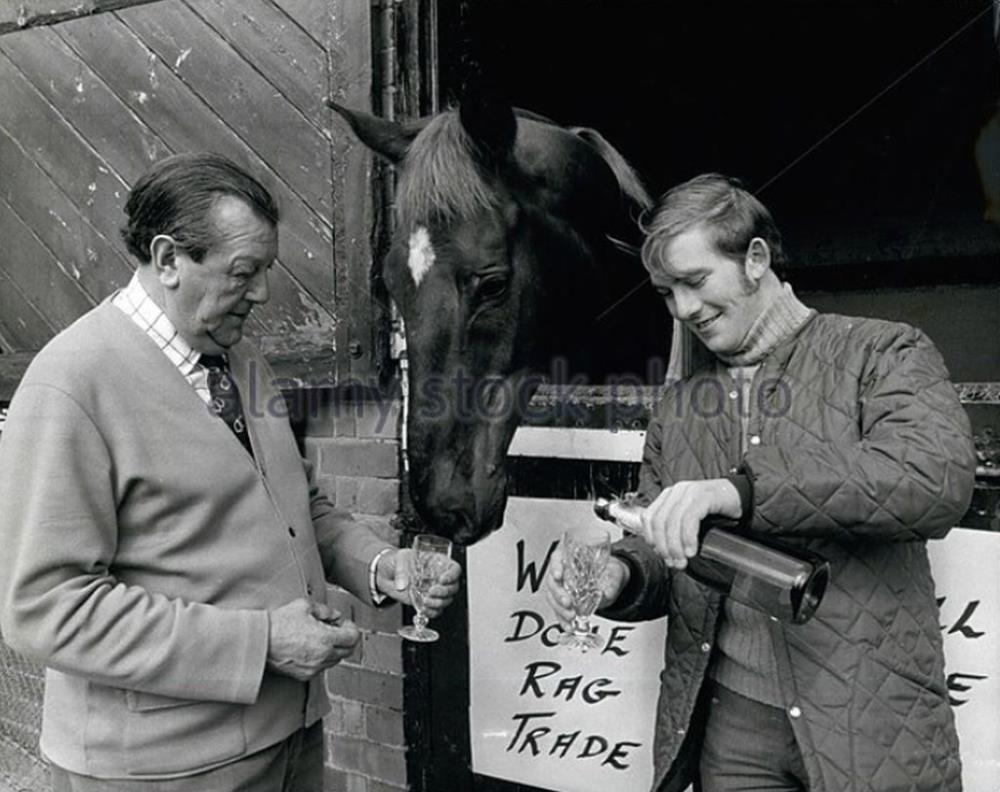 Fred Rimell celebrating Rag Trade's Grand National win with jockey John Burke