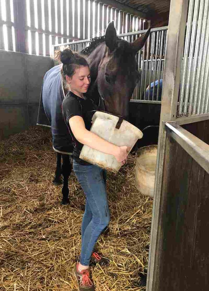 Sarah topping up Harry Topper's water bucket..