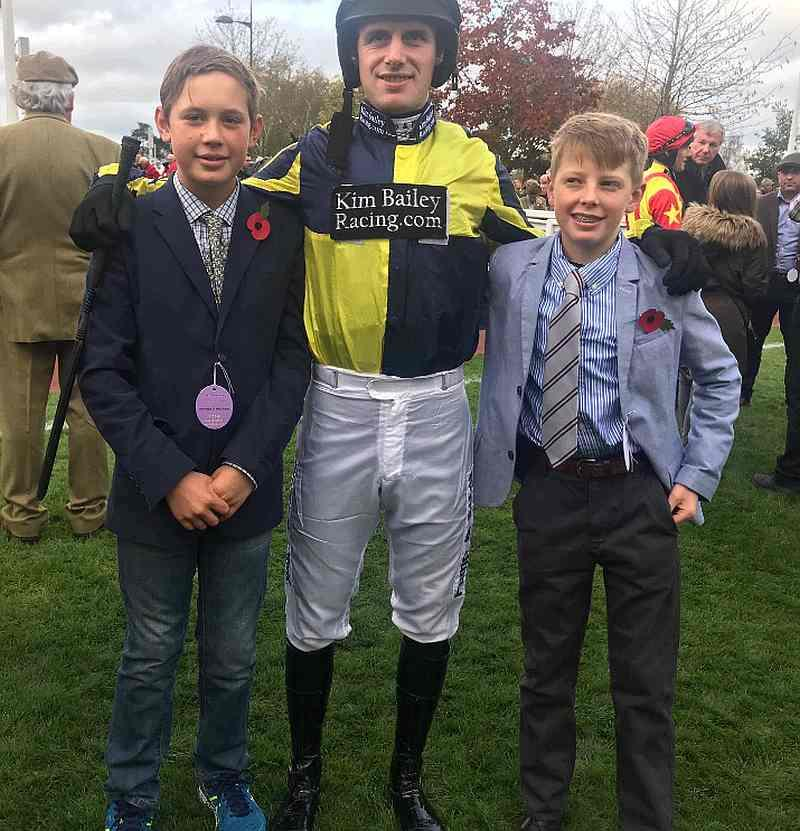 Archie Bailey and his mate Elliott England with David Bass