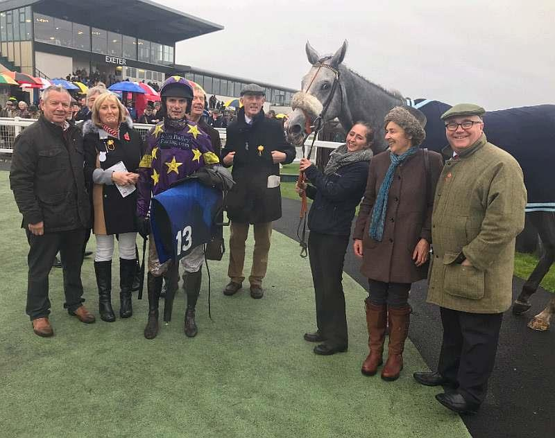 Silver Kayf and some of his team after his run