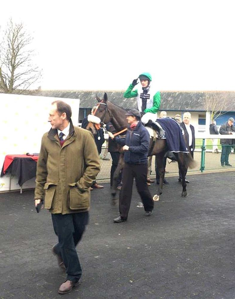 Vinndication passing Peter Kerr into the winners enclosure