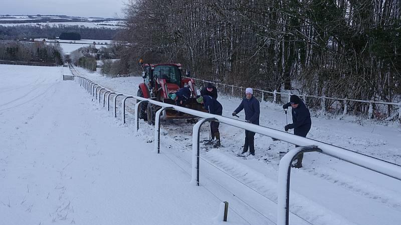 Digging the snow off the gallop and salting
