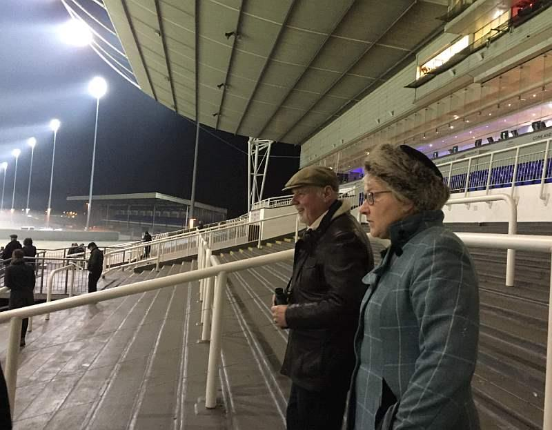 Packed stands to watch the lucky last at Kempton last night