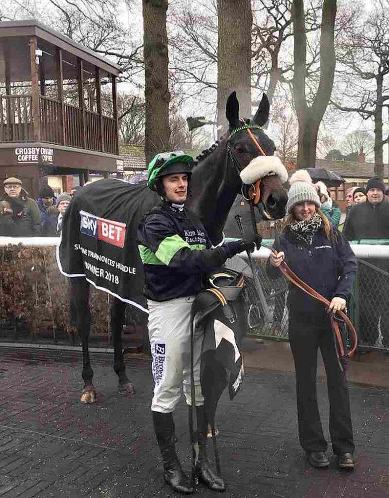 First Flow and David Bass after winning the Grade 2 novice hurdle at Haydock on Saturday