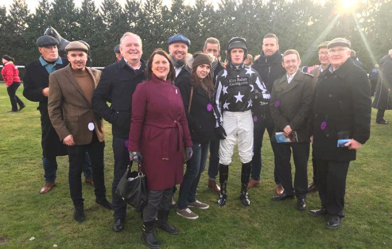 Imperial Racing's team of owners for Imperial Aura in the paddock at Kempton before his race yesterday