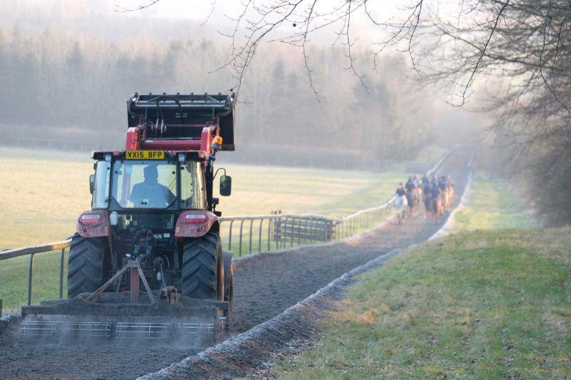 Tractor following the horses down the gallop