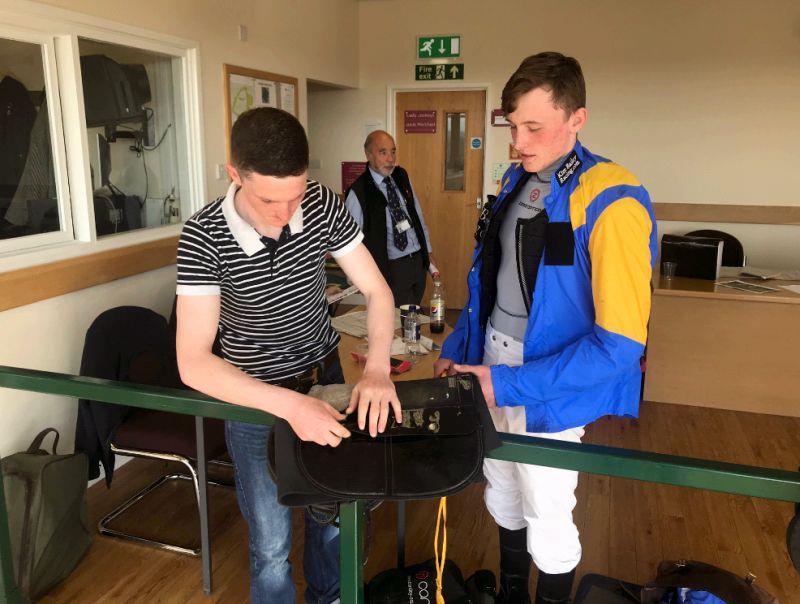 Mikey Hamill helping Liam sort his saddle out