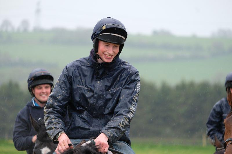 Zack in the rain.. smiling..