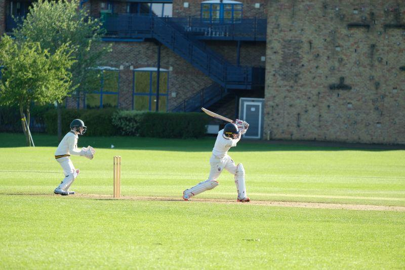 Archie hitting a six..
