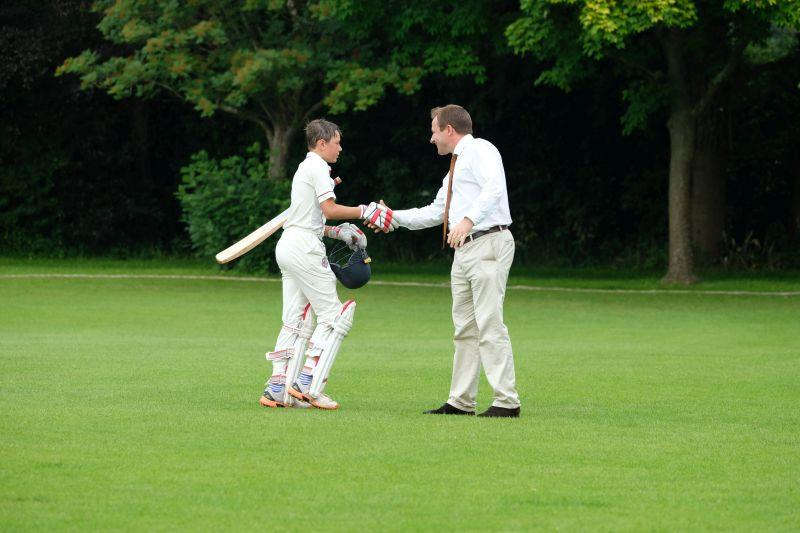 His cricket master Mr Sutton congratulating Archie on his unbeaten 133 .. only the second school 100 in the last 15 years