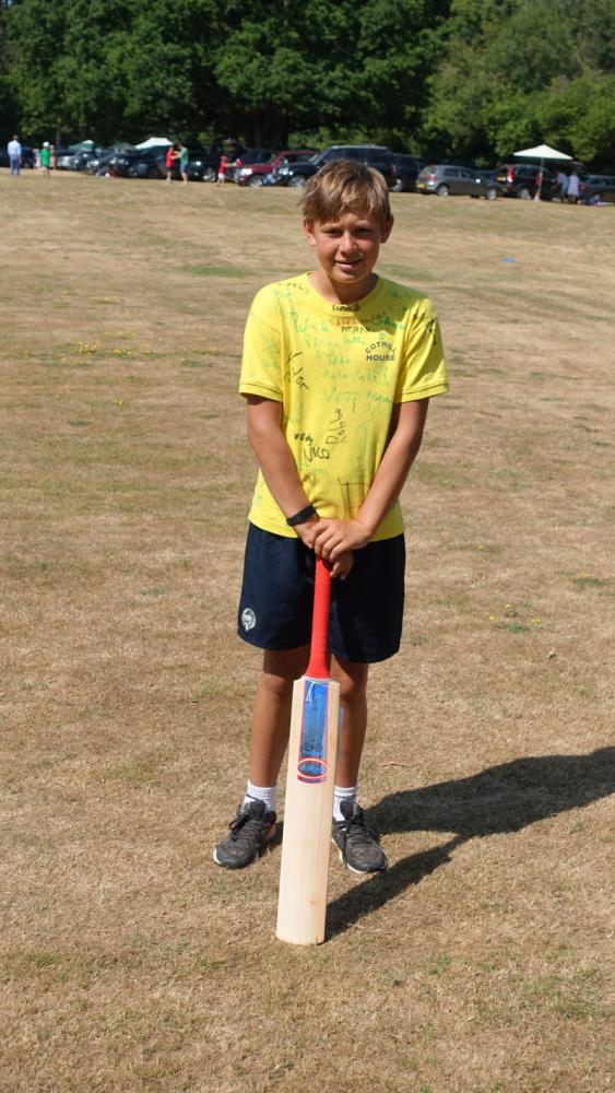 Archie with his new Hawk cricket bat.. Presented by the school for his 133 no