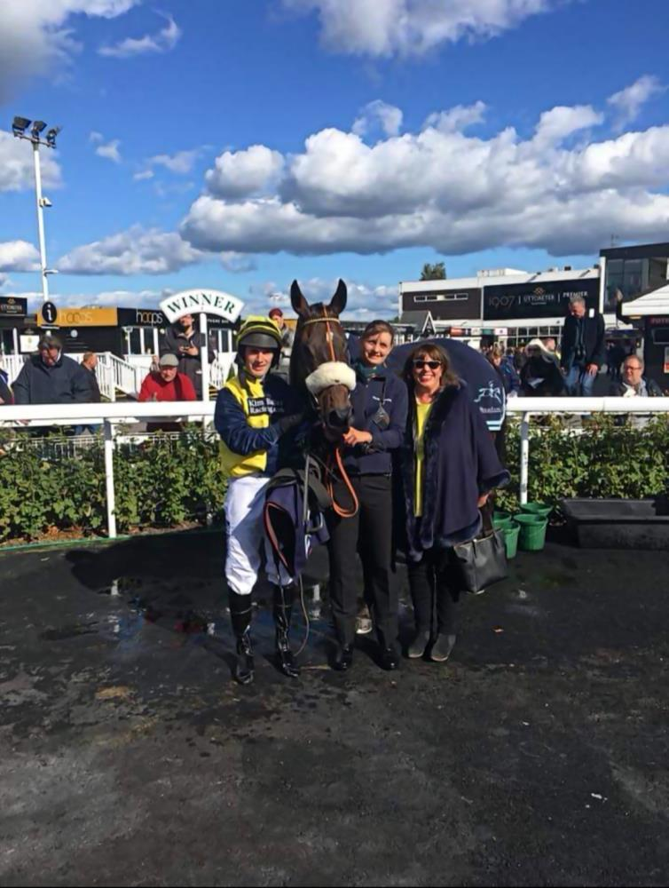 Minella Warrior in the winners enclosure with Julie Martin, Leigh Pollard and David Bass