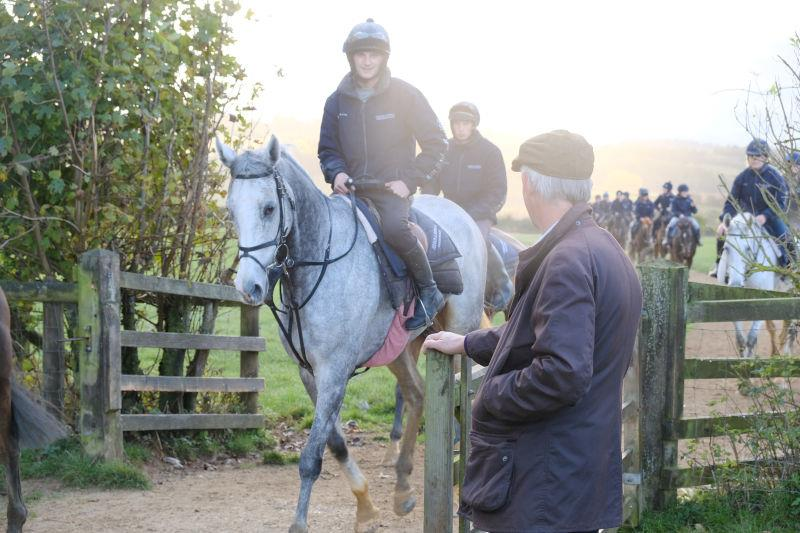 Steve Adams opening the gate for his horse Silver Kayf
