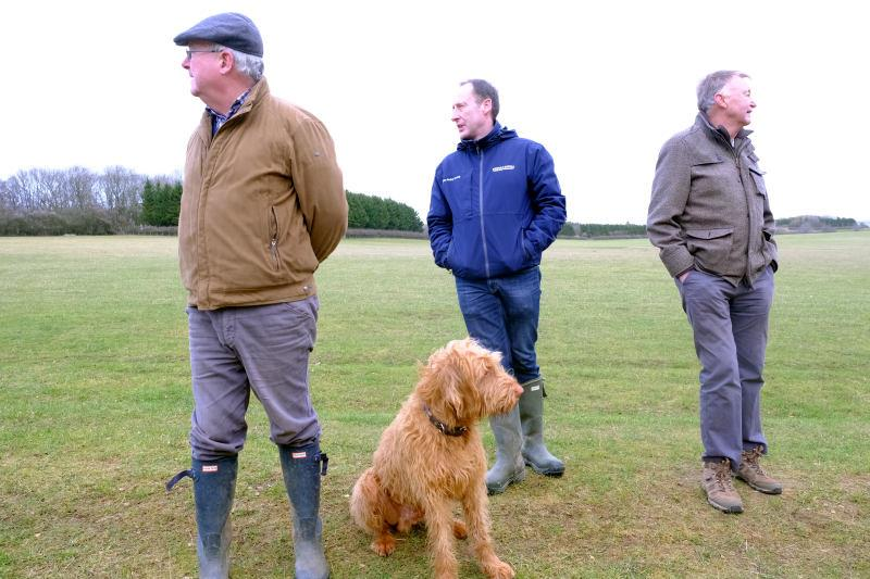 Charles, Peter and Colin and Dougie watching different horses.