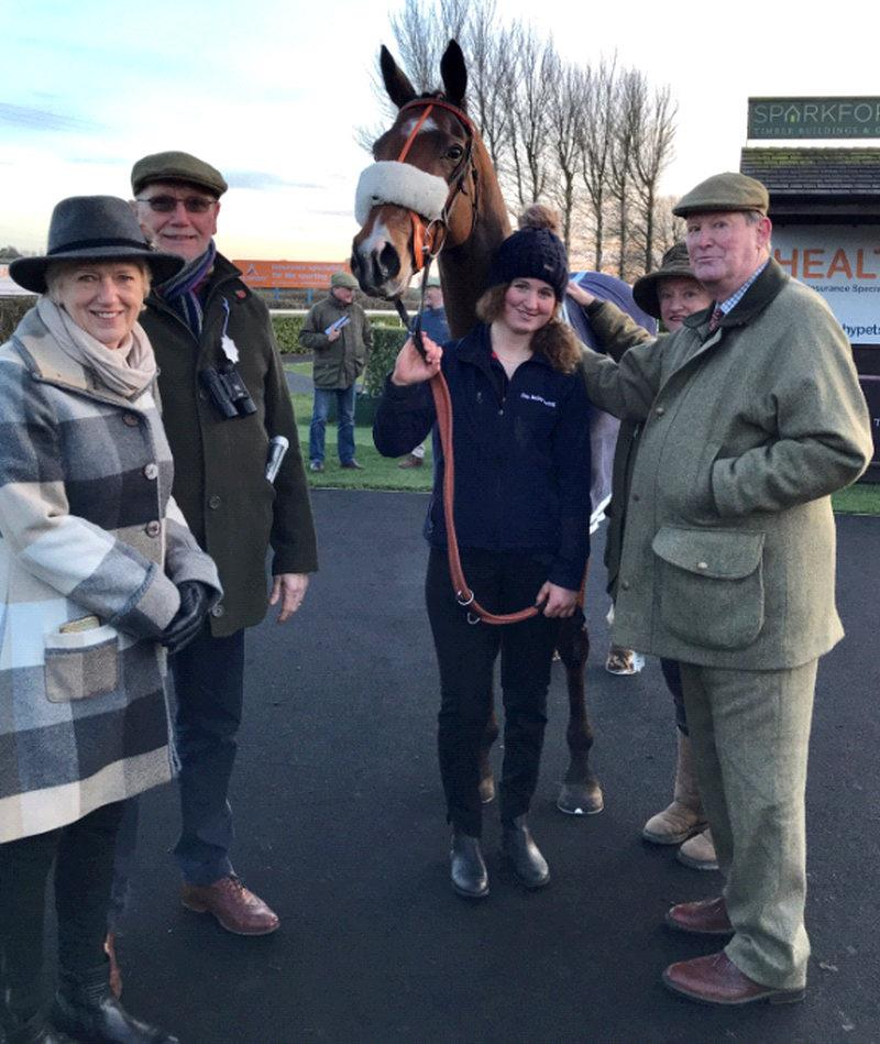 Sadlermor who was third in yesterdays bumper at Wincanton with his owners Lindy and Tony Elphick and Nicholas and Jill Sperling