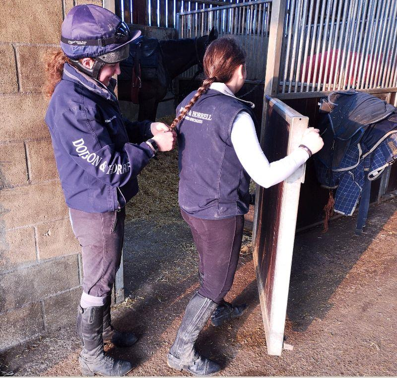 Poppy plaiting Aminah's hair before riding out Vinndication.