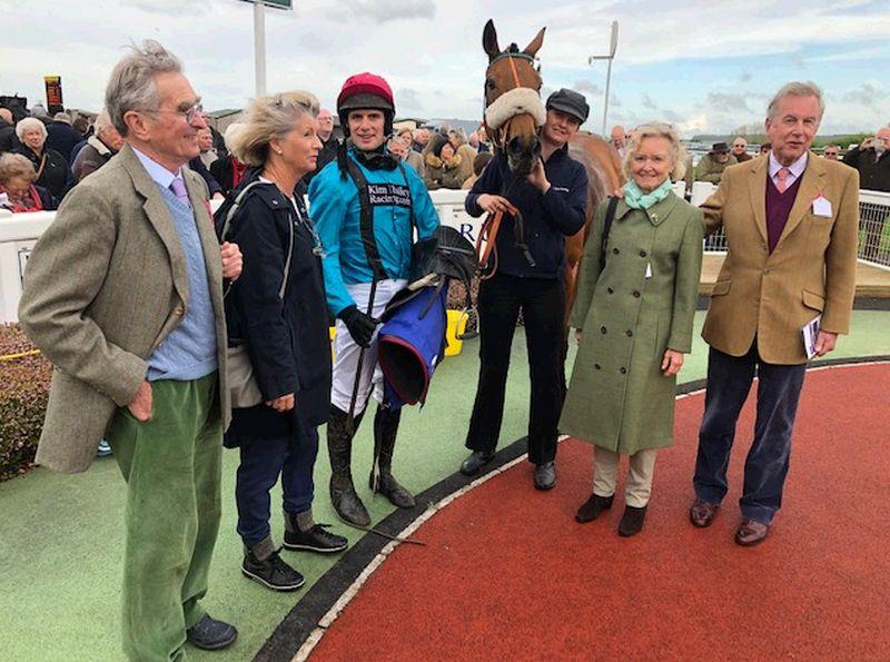 Tom, Cherry, Jane and Nicholas with Rose To Fame in a windswept winners enclosure