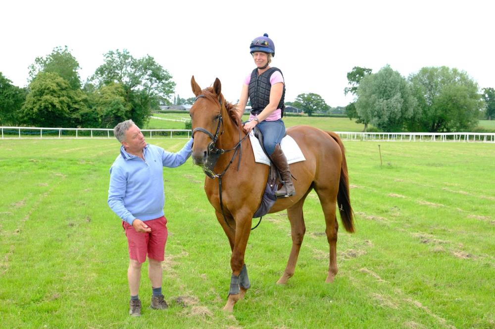 Martin Jones with the 3 year old gelding by Schiaparelli (GER) x Bisaat (USA)... Megan riding..