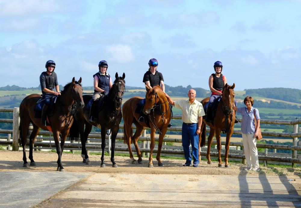 John and Veronica with their horses.. The Midnight Legend mare.  Blazon, Shantou Express and Another Venture