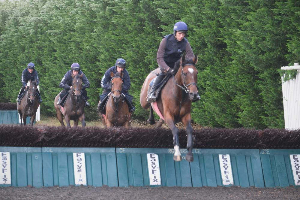 Charbel leading Imperial Aura, Commodore Barry and Minella Warrior over the plastic hurdles