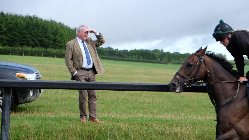 Kevin Clancy watching his horse The Rainbow Hunter flash past