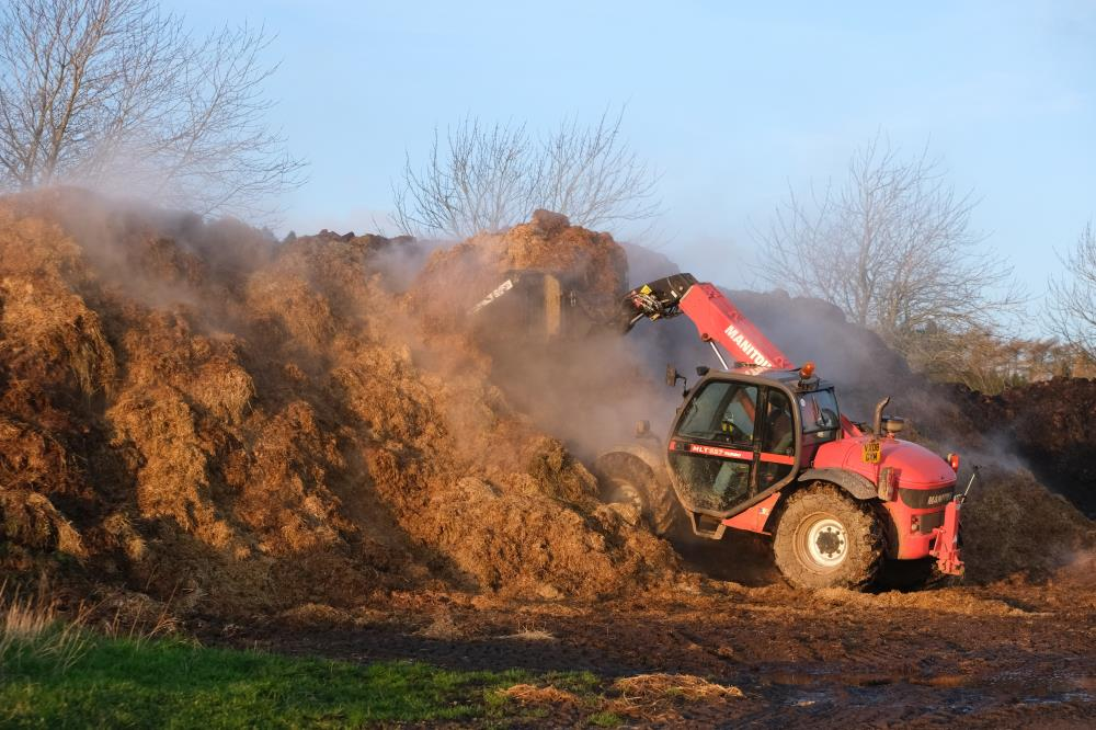 Pat moving the muck heap