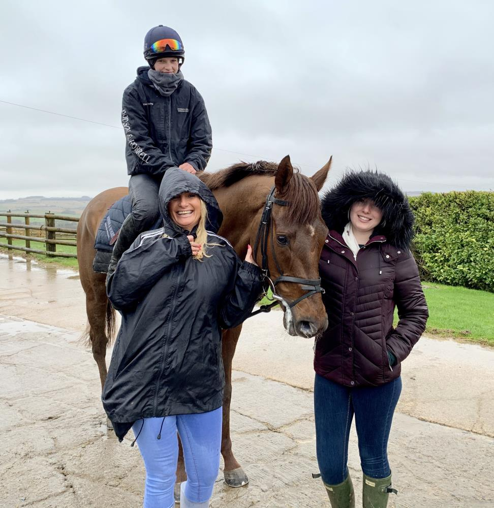 Debbie and Christina Hanson looking happy in the rain with their KBRP horse Shinobi
