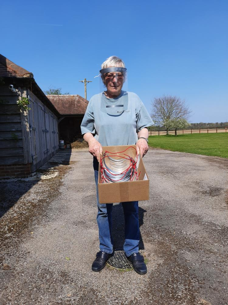 Elizabeth Kellar is modelling Paul's production of face masks, with the first batch for a local care home.