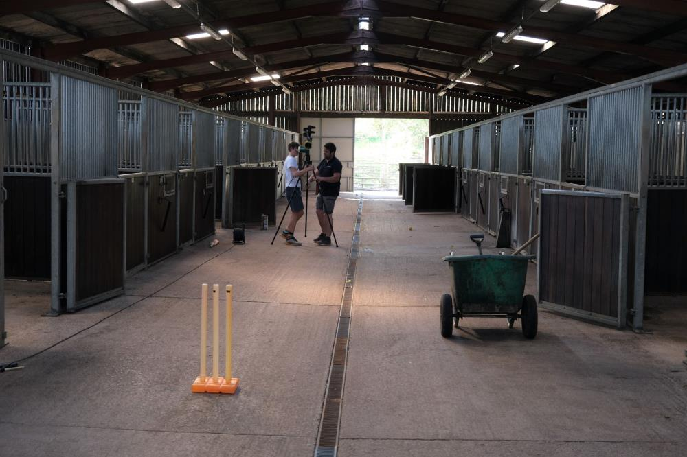 Now that the first barn is cleaned and painted out comes the bowling machine..