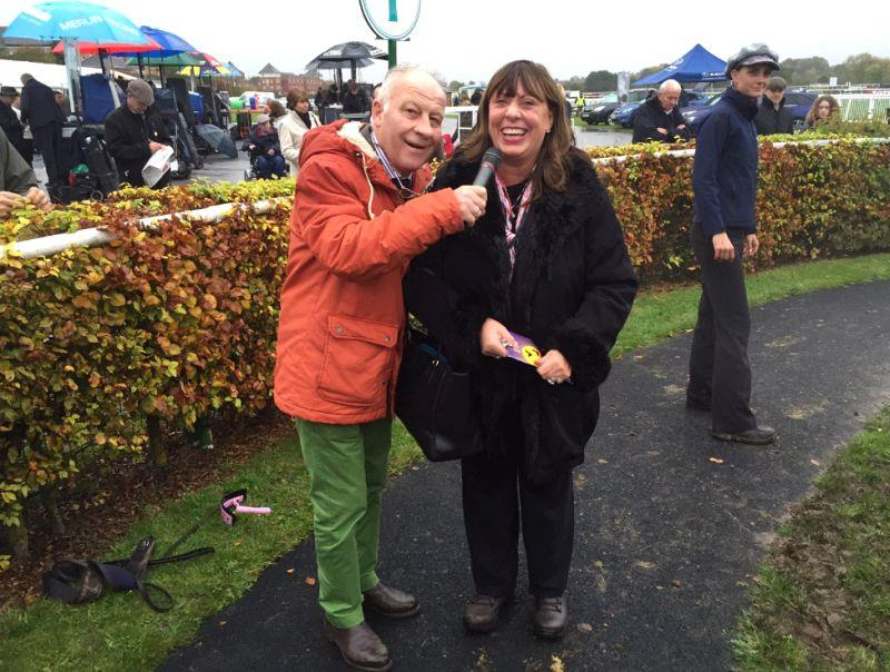 Colin Brown catching the happy owner Julie after the race