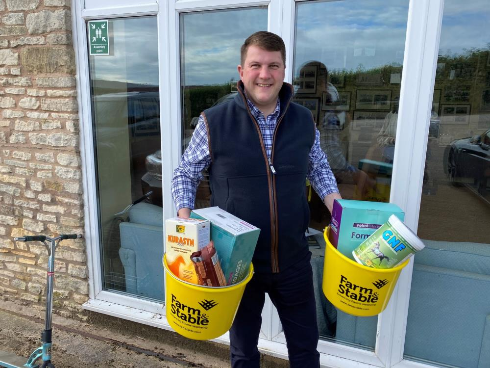 Laurence Norton from Farm and Stable with some gifts for winning the Lycetts  Award