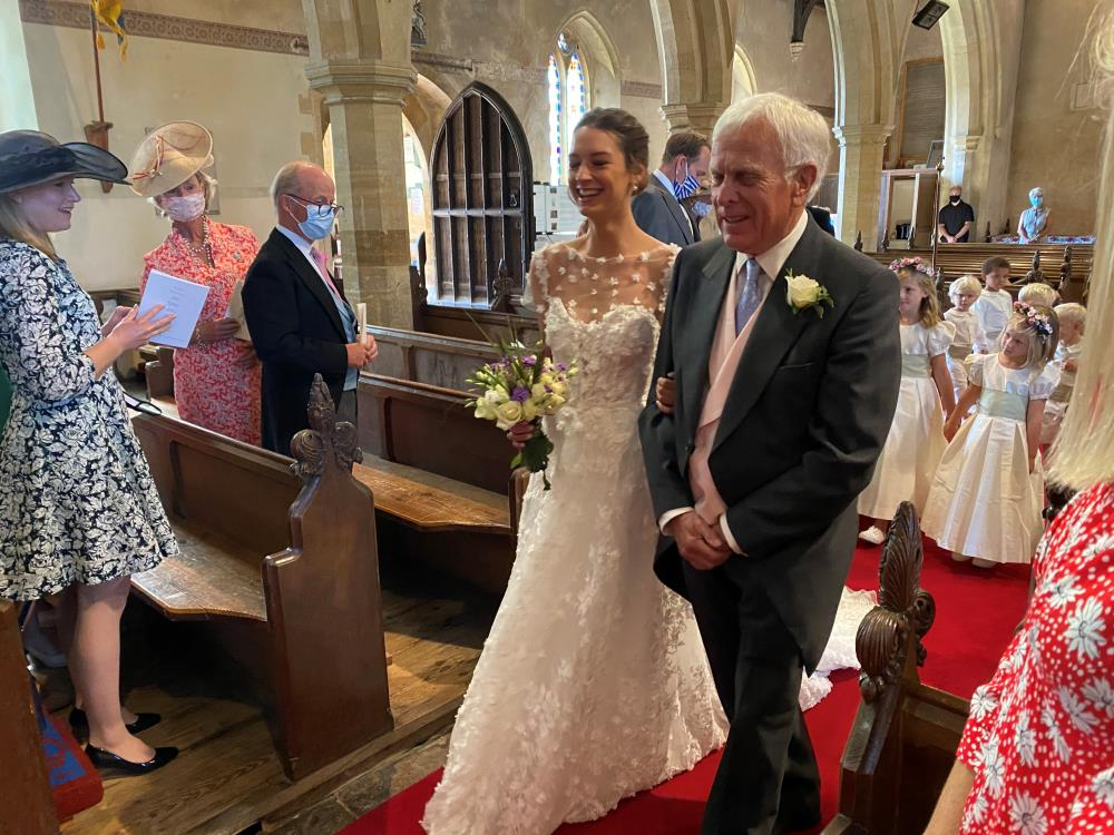 Peter Mordaunt and Patience head hown the aisle