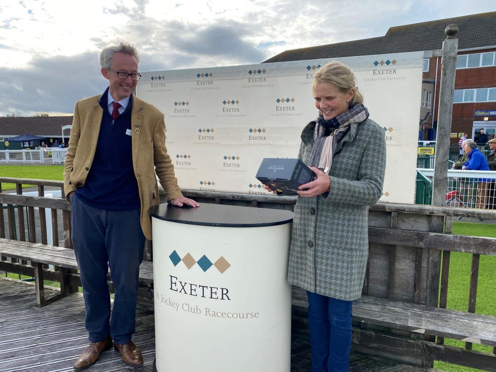 Exeter racecourse Chairman Duncan Sykes and Antonia Davies.. Prize giving