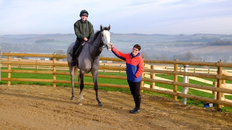 Michelle Dudderidge with her horse the 3 year old Grey Gelding by Kayf Tara
