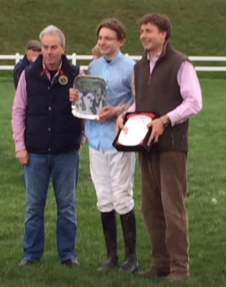 Gus Levinson (rides out here) in the middle collecting his prize after winning on Premier Portrait
