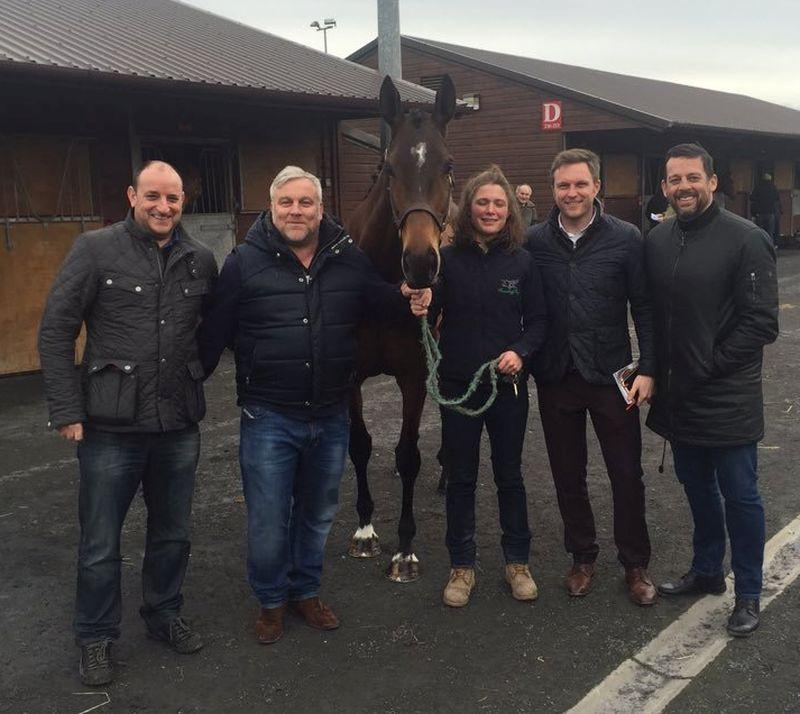 Lucy Egerton and her owners with her new horse Allez Encore