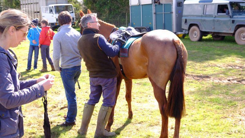 Simon Claisse tacking up the pony that Archie was about to ride..