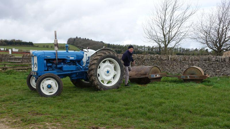 Pat and his old tractor.. Pat's pride and joy about to do some rolling work