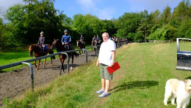 John Morris watching second lot on the gallops