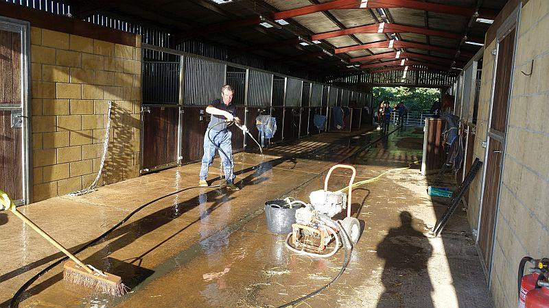 Higgs steam cleaning the barns in preparation for Sunday