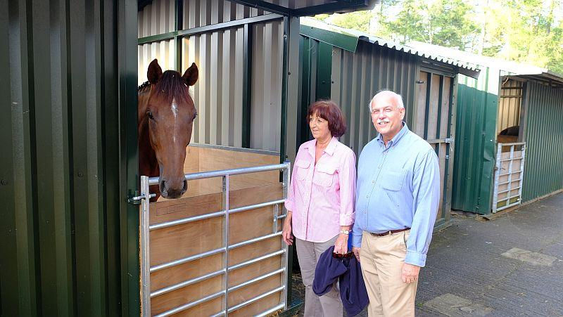 Biscuit who is in isolation meeting owners John and Veronica Full... Racing for Maggies