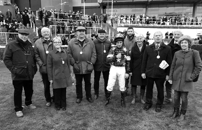 Replacement jockey Jamie Moore with Silver Kayf's owners before his run in the bumper