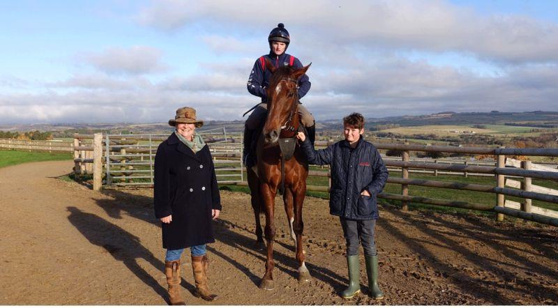 Kate Beim and her grandson Zac with her Racing For Maggies horse Biscuit