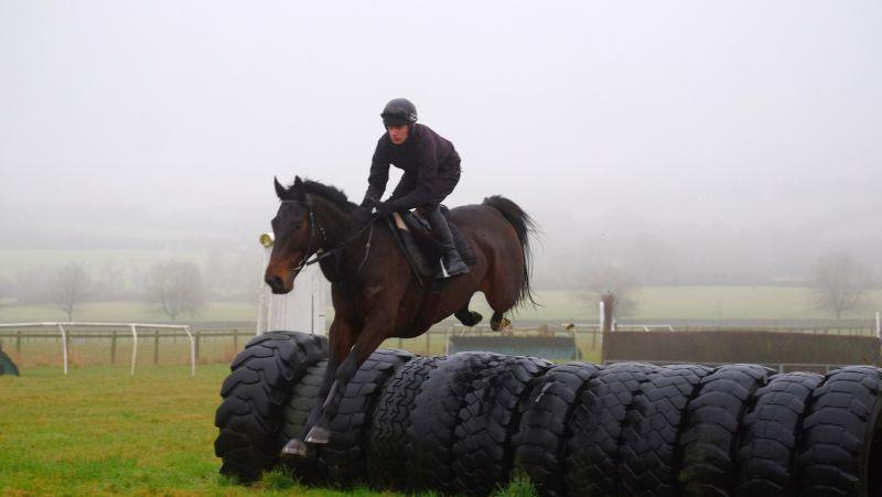 Harry Topper jumping the tractor tyre